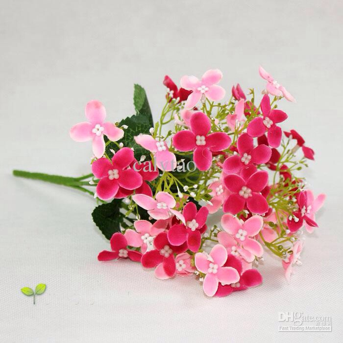 Arrange artificial flowers. Artificial flowers can be held in place by pouring salt into the vase, adding a little cold water and then arranging the flowers. The salt become solid as it dries and holds the flowers in place.