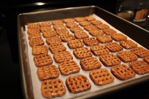 1.  Preheat oven to 170 degrees.  Line a baking pan with parchment paper.  Arrange as many unbroken pretzels that will fit.