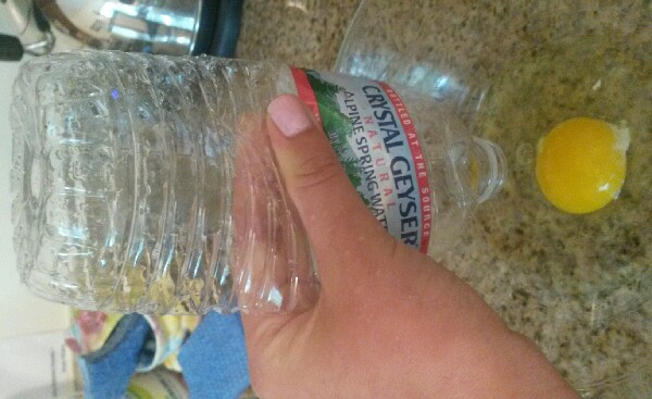 squeeze the bottle in its middle