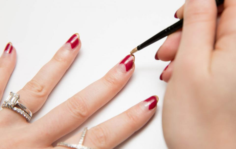 15. If the tips of your nails have chipped, add super-thin French tip. Now you're chipping no more and have a cool updated look.