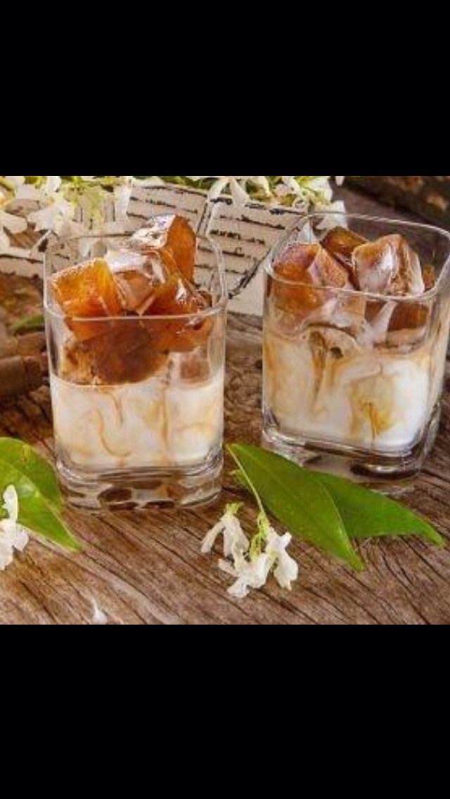 Freeze espresso into ice cubes. Place frozen espresso cubes in glass and top with your favorite coconut milk or almond milk. It's fabulous!