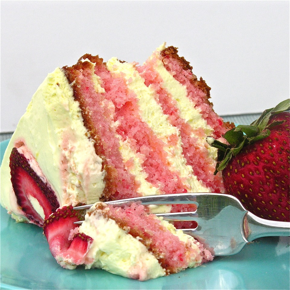 Moist strawberry cake layered with a rich lemonade cream filling.  Introducing summer—on a plate!