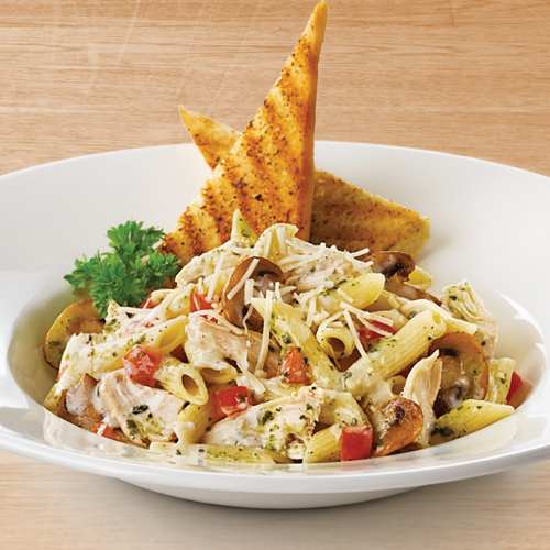 Ingredients:  *1(16 ounce) package penne pasta *2 tbsp butter *2 tbsp olive oil *4 skinless, boneless chicken breasts halves-cut into thin strips *2 garlic cloves, minced *Salt and pepper to tasta *1 1/4 cups heavy cream *1/4 cup pesto *3 tbsp grated Parmesan cheese