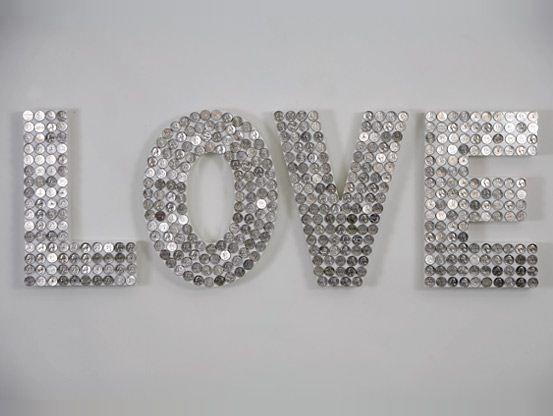 Wood Letters and Dimes! (Or pennies.) Could also do foam-core letters and big sequins. Bit cheaper and lighter.