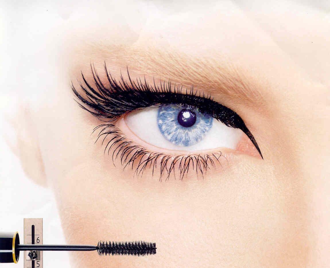 Enlarge eyes bye pulling wand outward toward the edge of your eyebrow