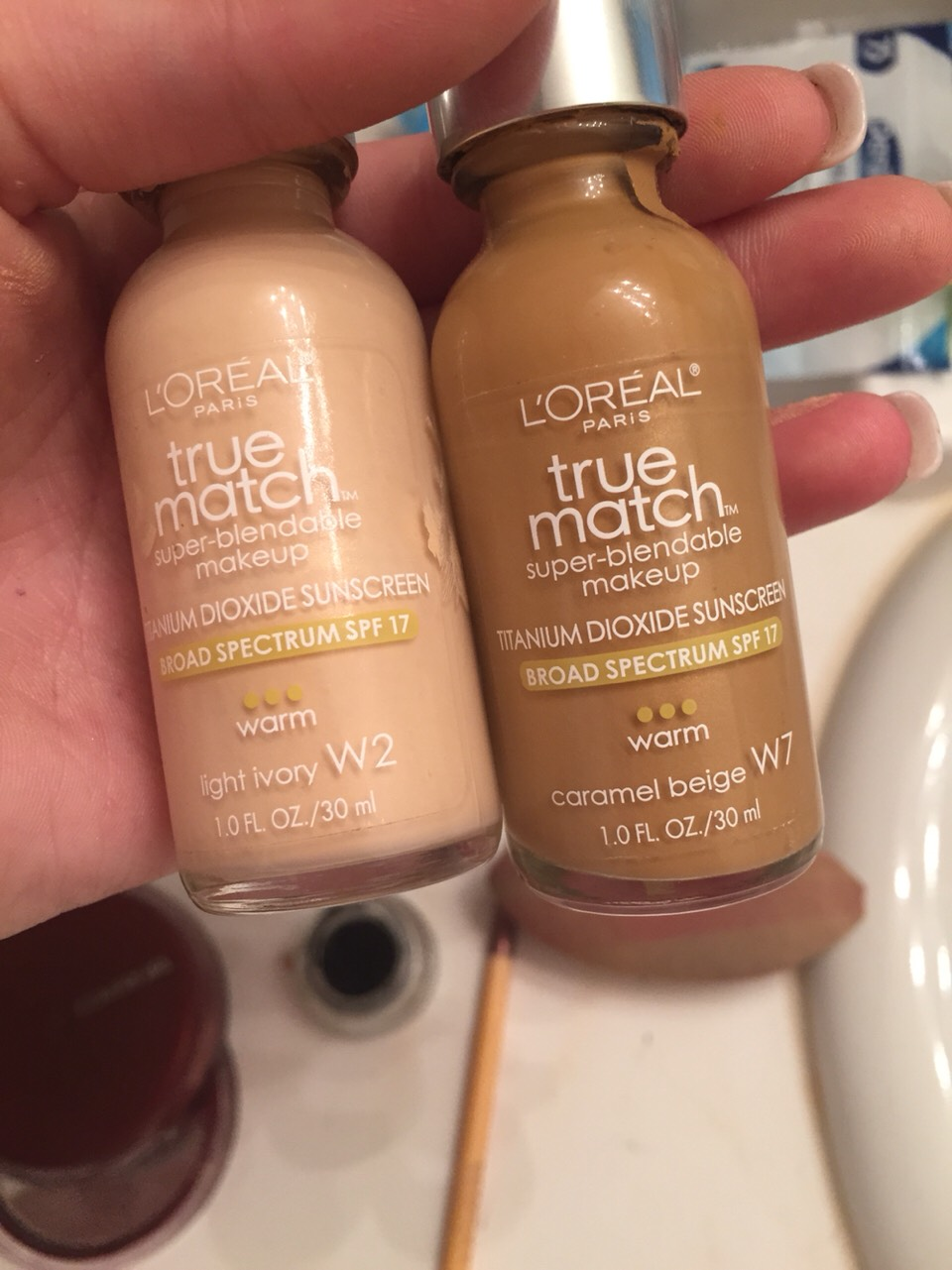 A make up way lighter than your skin tone (highlight) and one significantly darker (contour)
