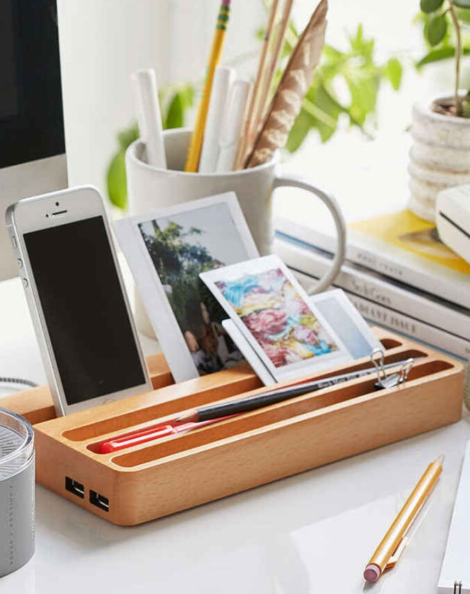 This wooden charging station with two USB ports to keep your devices in one place. ($50)  http://www.urbanoutfitters.com/urban/catalog/productdetail.jsp?id=36455145&category=SEARCH+RESULTS