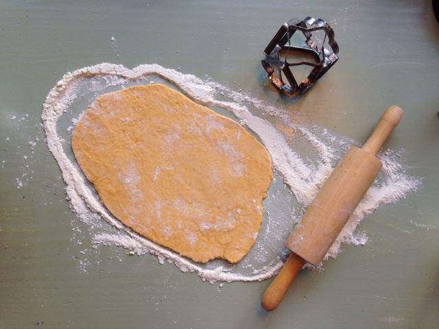 Put some flour on top of it and start rolling! You can make it as thick or thin as you like. Mine was about 0.5 cm. Then, pick a cookie cutter!