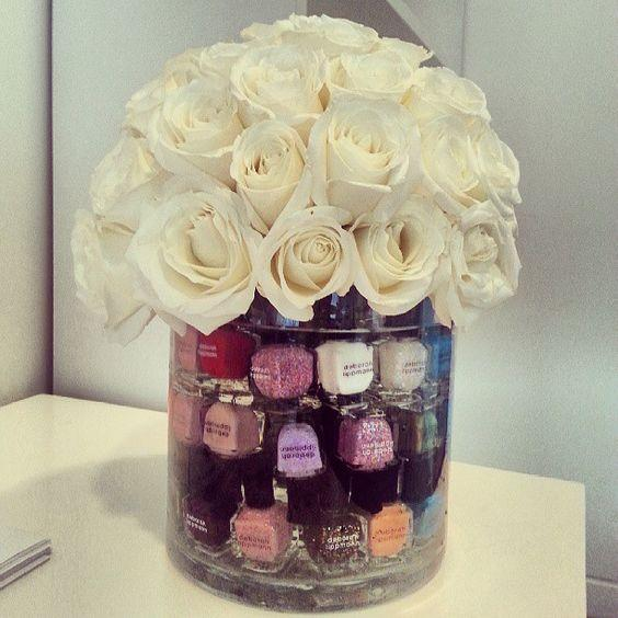 Flowers topping nail polish in vase