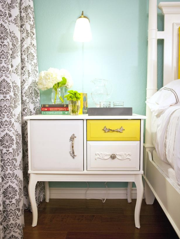 In a Day: Add Paint + Vintage Pulls This dresser has some serious personality, no? Design on a Dime host Casey Noble made it one-of-a-kind by painting one drawer front bright yellow and adding vintage pulls.