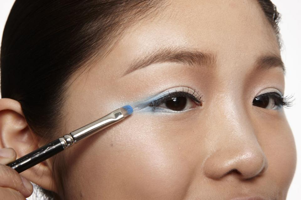 1  Apply Shadow To give your eyes an ethereal effect, apply white cream shadow on your lids and across your lower lash lines, then blend a sky-blue shadow into the outer corners.