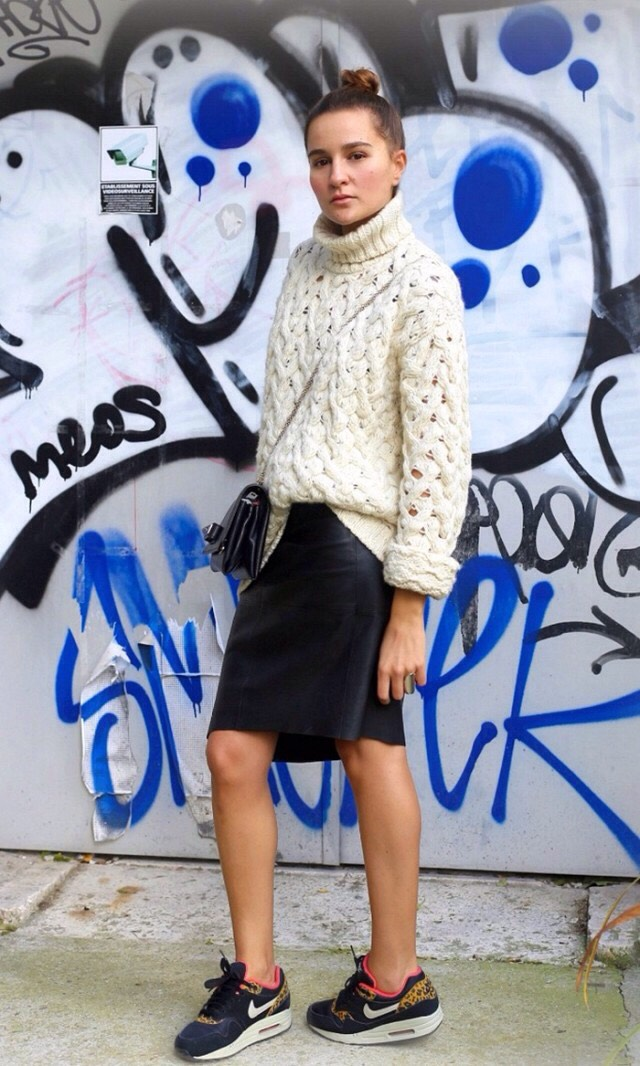 Add One Alluring Piece  A body-skimming leather skirt feels even more intriguing when contrasted with a chunky knit sweater and sneakers.