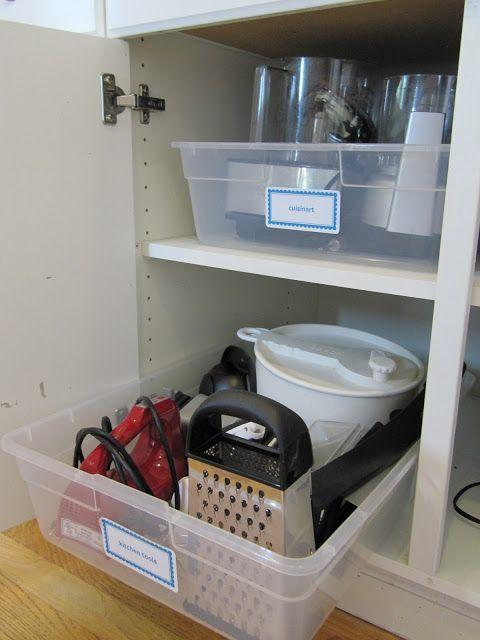 1. Pretend Pull-Outs I have so many kitchen gadgets that get lost in the back of my deep cabinets that I forget I even have them! Here is a tip from Everyday Organizing: use plastic bins as pull-outs! Take it a step further and group your items into different categories and label each one.