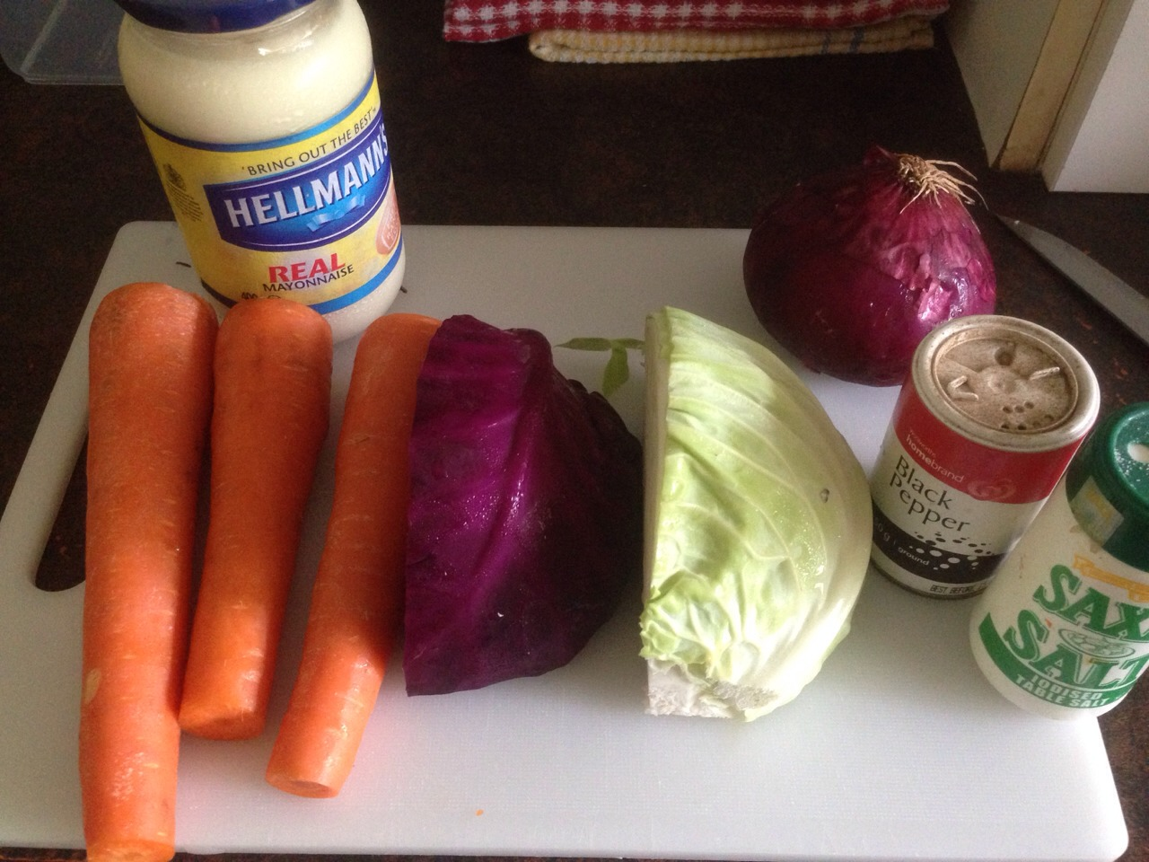 All you need for coleslaw, 3 carrots,1/4 white cabbage 1/4 red cabbage 1 onion. Salt and pepper and mayonnaise :)