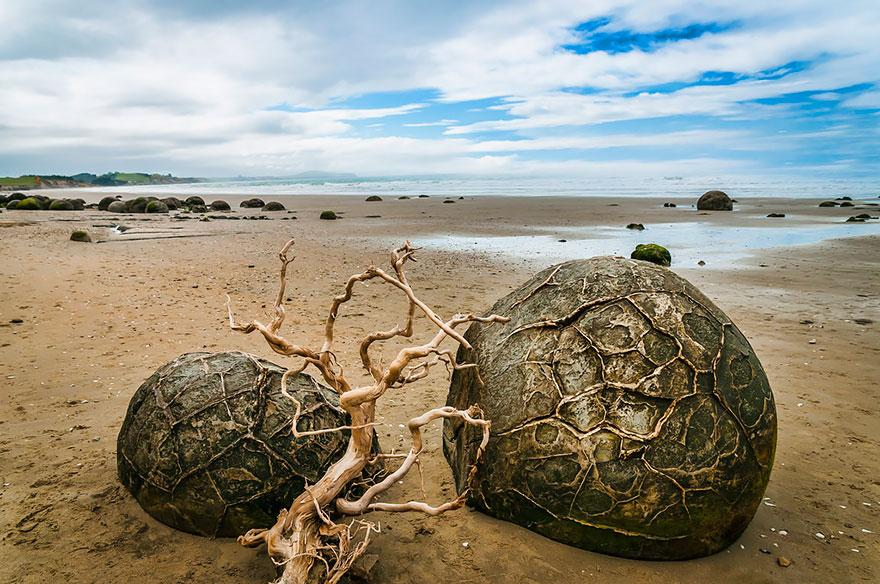 "The Moeraki Boulders (Dragon Eggs) Beach They call this beach ""Dragon Eggs"" or Moreaki Boulders beach because of the unique rock formations it has. The water has been washing away rocks for years but for these heavy spectacular rocks, the water has only helped shape them."
