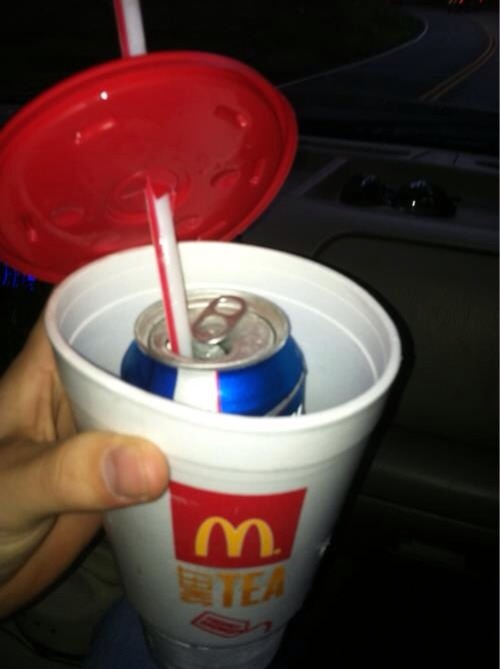 Empty Cup, Put Beer Can in Cup, Fill Ice Around Can, Stick Straw in Can, Secure Lis. Keeps Drinks Cold and Hidden :)