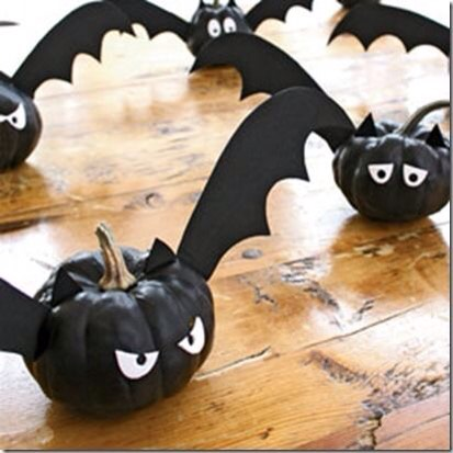 Tiny pumpkins , I used a black permanent marker and construction paper. I used tooth picks to stick the wings in them