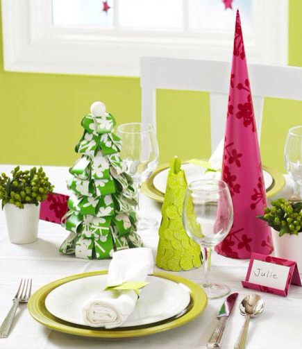 Wrapping paper trees  Trim the dinner table with paper trees in gleeful holiday colors and patterns. For the simplest tree, shown in fuchsia, wrap paper around a foam cone. Trim to fit, and secure with pushpins. Overlapping circle cutouts create the scalloped look of the chartreuse tree.