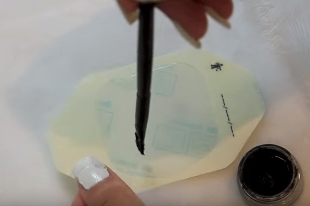 Color/paint the clear bandaid with a gel eyeliner