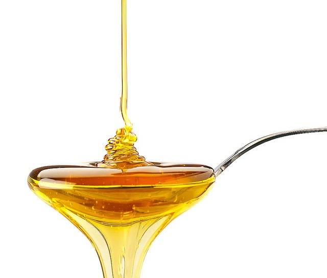 Take a spoonful of honey. Honey acts like a lotion to lubricate or coat the throat and temporarily relieve pain. A teaspoon of honey swallowed before bed will ensure a cough-free slumber.
