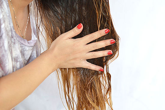 massage the mixure in your hair till whole head is drenched with the mixure