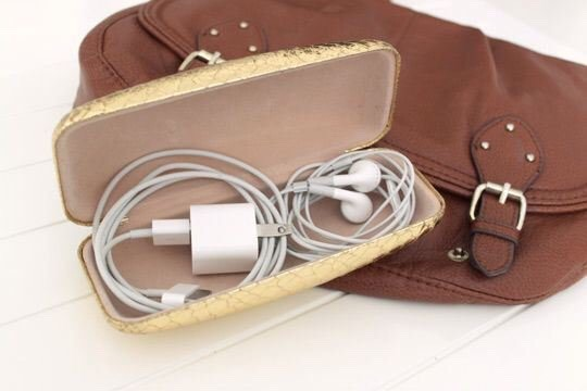 Put cords and headphones into a glasses case so they won't get tangled, lost, or damaged in your suitcase.