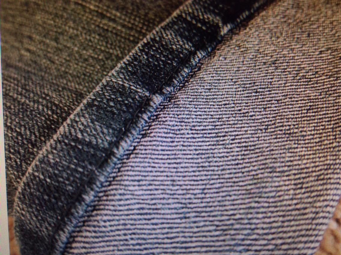 Sew right next to the original hem; like so.