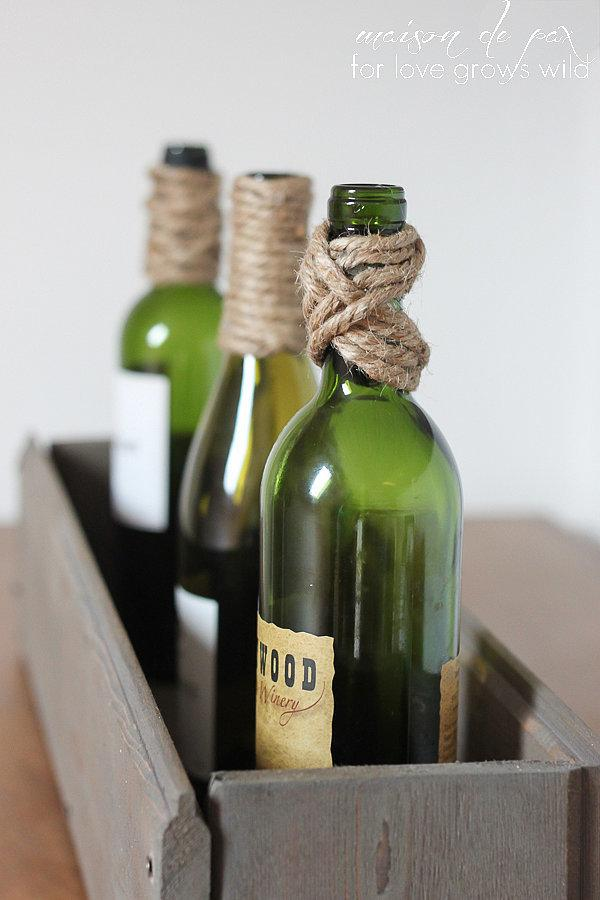 A Twine-Wrapped Trio Add a natural piece of decor to your home with a trio of twine-wrapped bottles. As seen on Love Grows Wild, varying up the styles of the wrap adds visual interest. The trio display permits showing off bottles from special occasions.
