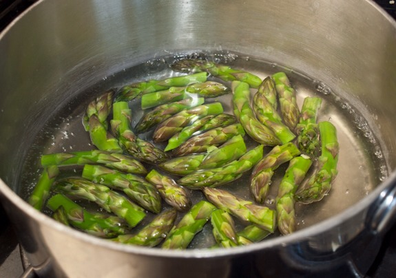 Finally, cook the asparagus tips in boiling water until tender-crisp.
