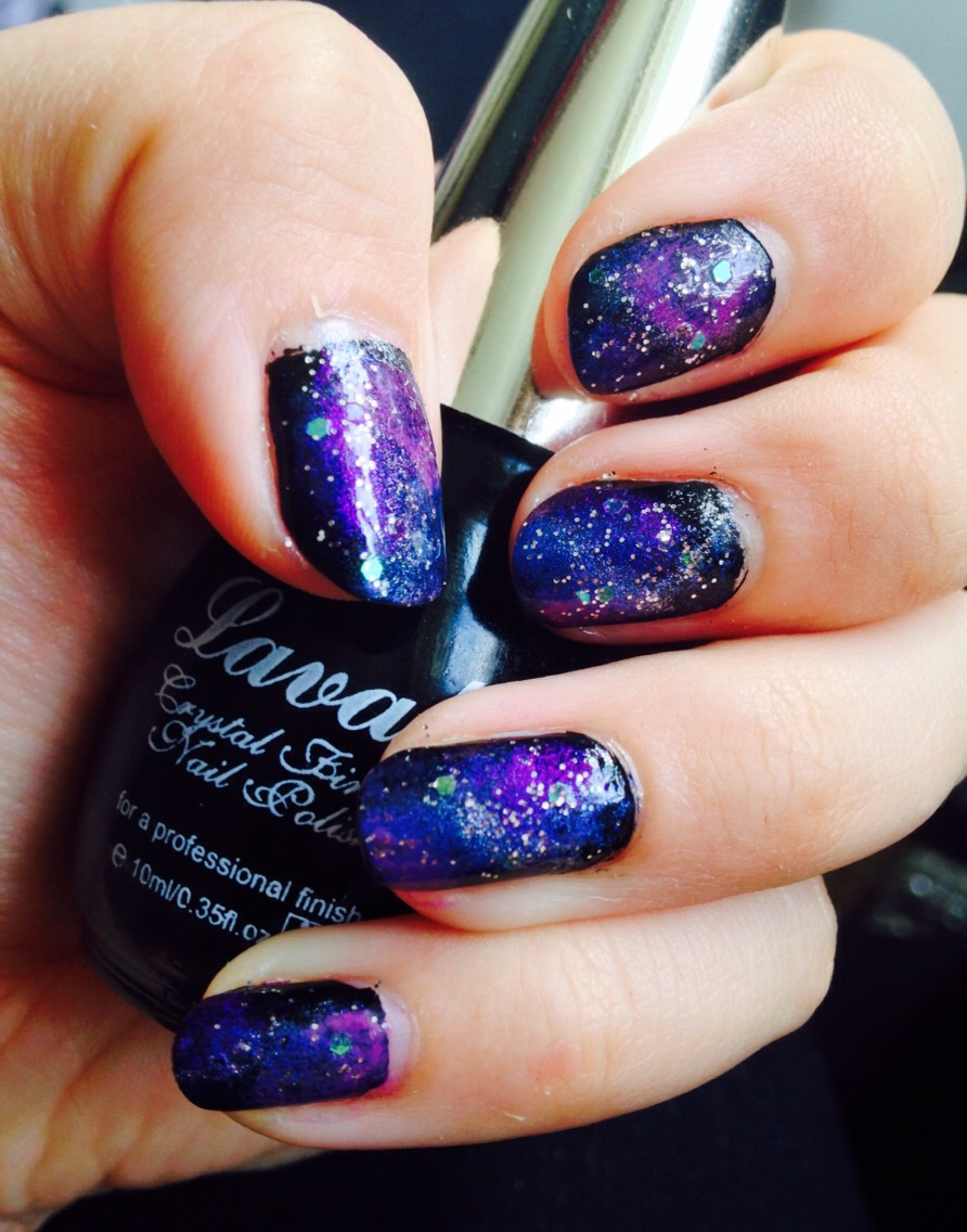 Take your small glitter and paint over the whole nail. Then take your larger glitter and put a few specs on the nail in random places. Finish with a top coat and your done! Beautiful galaxy nails!