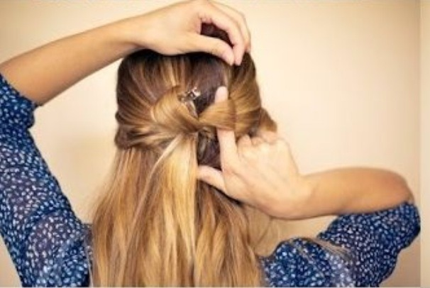 Pull strands of hair from the top to give volume. Do the same for both sides