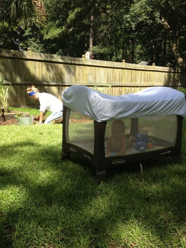 If you're out in the yard with the baby, protect them from mosquitos with a crib sheet.
