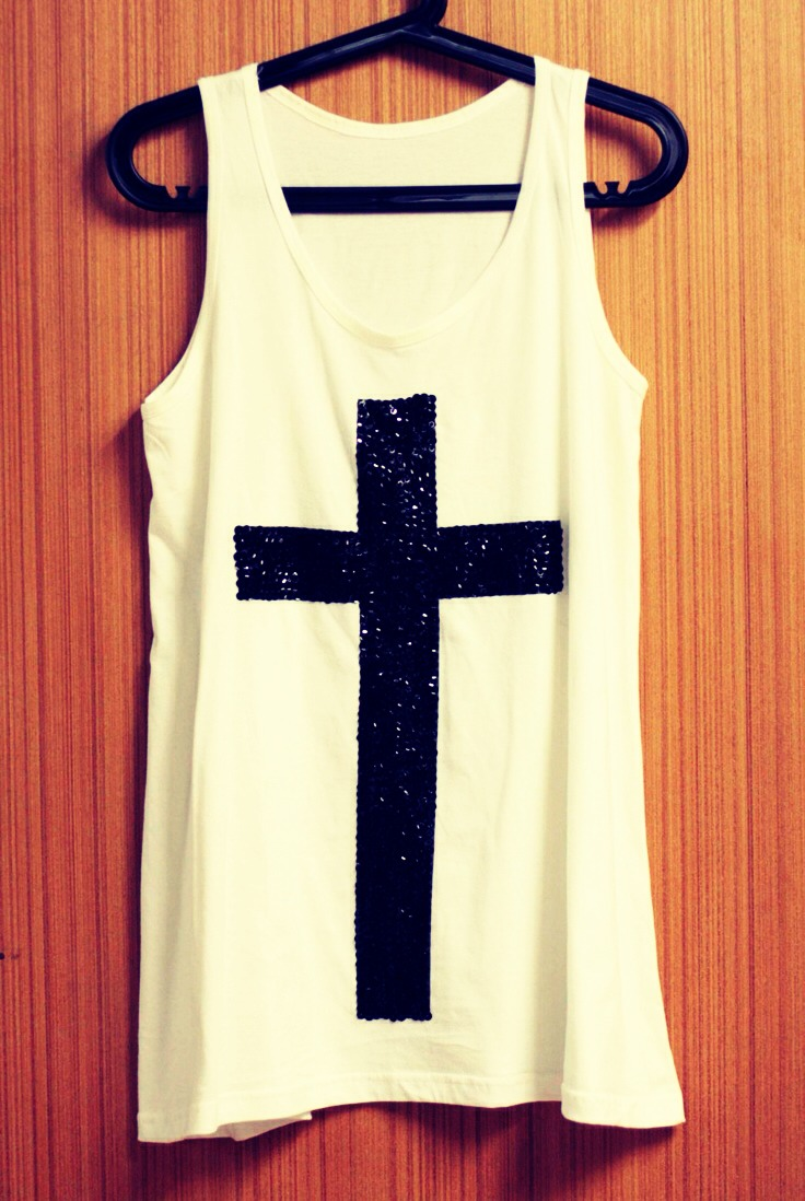 CROSSES , they have been out way too long and now should be extinct on clothing