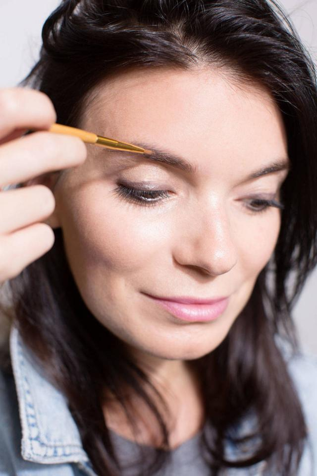 9. Use a small, straight brow brush to fill in your arches flawlessly.