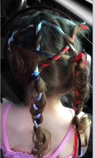 One view of my three year old daughter styling this braid.  (She was styling safety ear muffs for the fireworks, as well.)