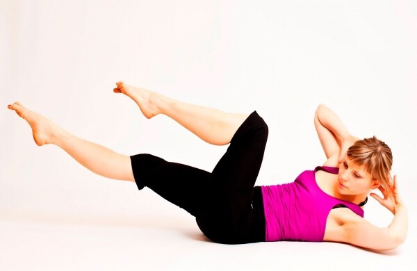 First, lie on your back then place your hands behind your head, ready to crunch. Engage you abs and bring your knees up to around 45 degrees. Slowly begin to pedal with your feet, as you would a bicycle and, at the same time bring your elbow up to the opposite knee.