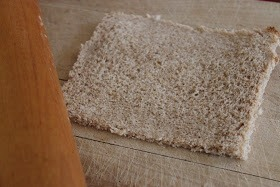 To Prepare  Trim the crust from the bread.  Flatten the slices slightly with a rolling pin.