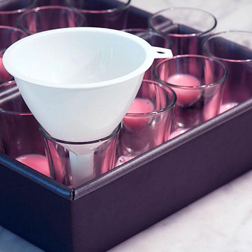 A funnel also works well for making uniform layers (and not spilling on the sides of the shot glasses)!