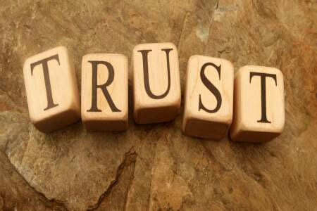 TRUST=KEY Trust comes from constant communication.  You both will continue with your social life and go out with friends, so trust each other and believe. when you visit each other take some time to meet people she/he talks about or visit places he/she goes to.