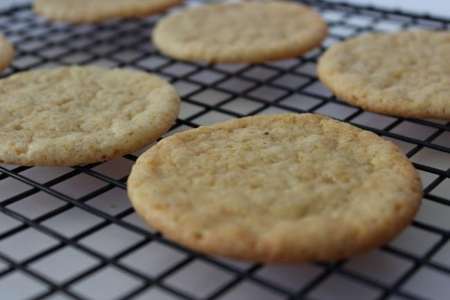 Mix together powdered sugar, butter and eggnog until blended. Spread icing on cooled cookies and sprinkle with nutmeg.