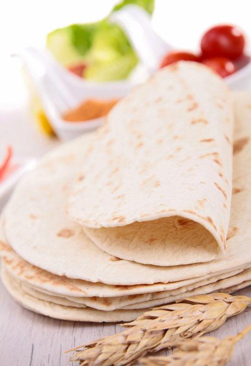 """Tortillas are a very forgiving, basic """"bread"""" recipe that requires very little effort or experience. This traditional Mexican thin flatbread is often used to make dishes such as burritos, enchiladas and baleadas. You can make your own at home for just pennies with this simple recipe . . ."""