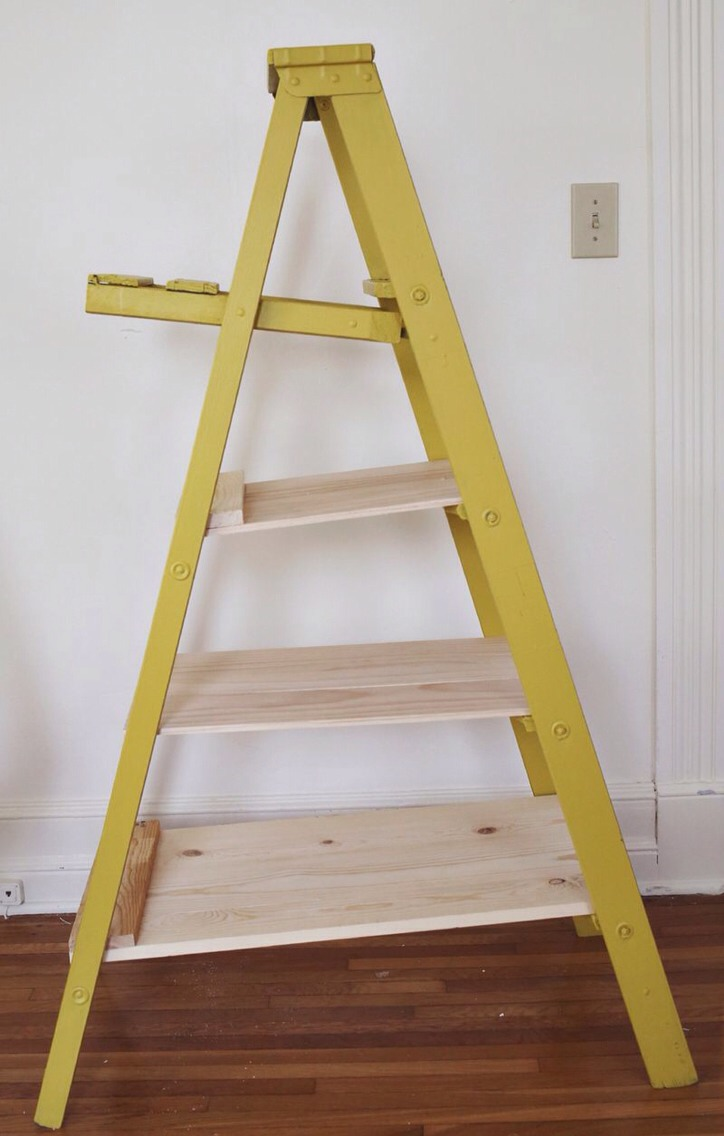 I thought simply adding a few planks of wood the appropriate length would be enough but then I found that the rungs on one side of the ladder were slightly shorter than the other. This caused our shelves to slope downward, so much so that I worried display items might slide.