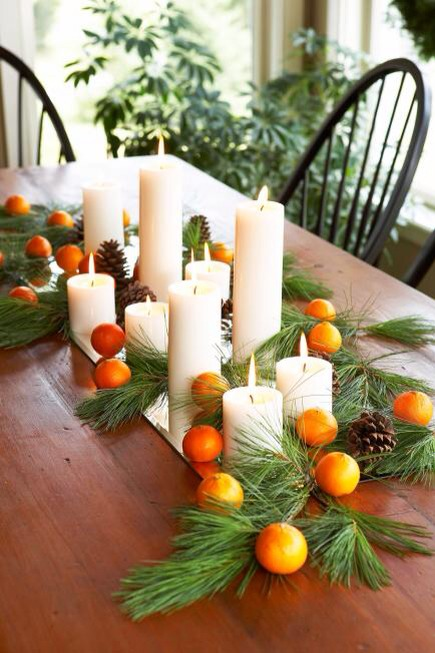 Fruit fillers  Place pillar candles, evergreen branches, pinecones and clementines on a beveled-edge mirror for a nature-inspired tabletop arrangement. Don't like orange? Bring in green pears or red apples for traditional holiday color.