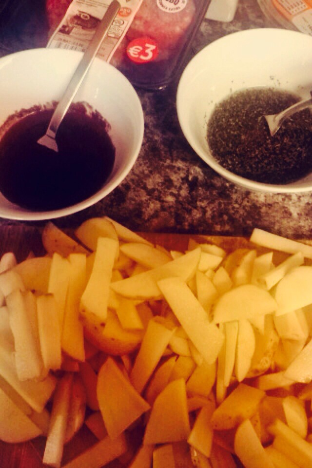 Wash and cut the potatoes into chip or wedge like shapes.  In one bowl, mix olive oil and paprika. In another, mix olive oil and the Italian herbs.  Dip half of the potatoes into one bowl and the other half in the other.  Place on a foiled baking tray and cook for 20-30 mins @ 220C