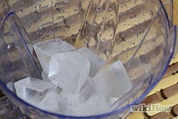 Get your blender or kitchen machine and fill it about halfway with ice. The ice can either crushed or chopped.