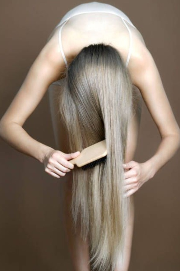 Flip head upside down and gently brush hair 2-4 minutes every day. This helps bring the natural oil to the end of the hair. It also helps stimulate the hair follicles by reversing the blood flow