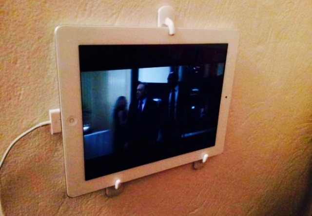 Use 3M wall hooks to mount your iPad! Great for easy removal and replacement too!
