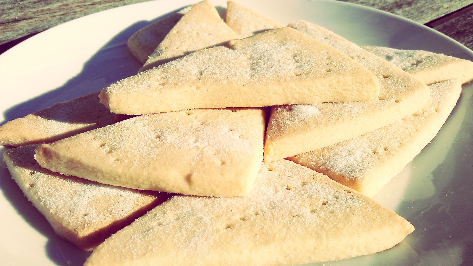 Ingredients 200g/7oz unsalted butter, at room temperature, cut into small cubes 100g/3½oz sugar, plus extra for sprinkling 1 teaspoon of vanilla extract (you can use other flavoured extracts too) 300g/10½oz plain flour, sifted, plus extra for dusting