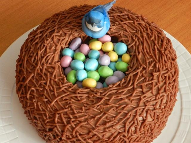 Once your *nest* design has been completed, fill the nest with your choice of coloured candy Easter eggs.  I used M&M's.  If you are good at fondant sculpture, you can make the bird.  As you can see, I bought a little inedible one to decorate the nest.