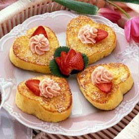 Cut bread slices with a 2 1/2- to 3-inch heart-shaped cookie cutter. Combine half & half, eggs and vanilla in 9-inch pie plate; mix well. Dip 4 bread shapes into half & half mixture, turning to coat both sides; let stand 1-2 minutes.